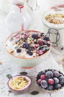 Bowl of vegan coconut yogurt  with berries, puffed amaranth, pumpkin seeds and raspberry pulp - SBDF002795