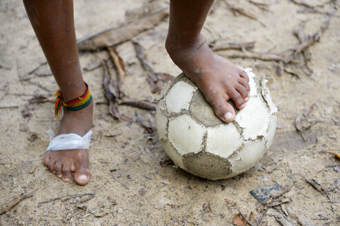 Brazil, Itaituba, Pimental, barfeoot boy with football - FLK000700