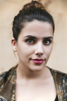 Portrait of young woman with red lips and bun - RTBF000157