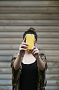Young woman taking a selfie with smartphone - RTBF000160