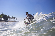 Indonesia, Bali, surfer on wave - KNTF000276