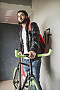 Young man with fixie bike - RAEF001083