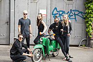 Group of five black dressed friends with green moped - CHAF001664