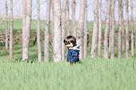 Portrait of little boy walking in a field - XCF000082