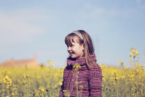 Portrait of little girl standing in front of rape field - XCF000088