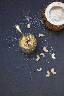 Chia pudding in glass, coconut, cashew nuts and coconut flakes - FAF000072
