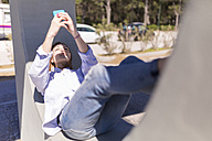 Italy, woman taking selfie with smartphone while having a rest in the shade - BOYF000302