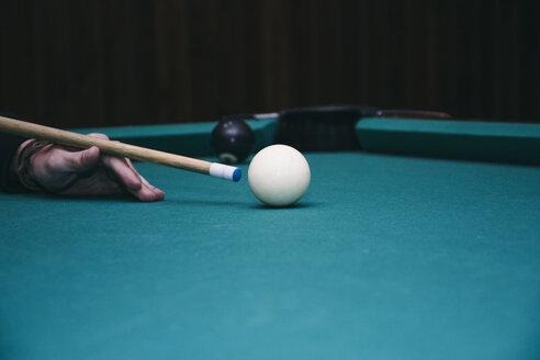 Hand of a man playing pool billard in a bar - ABZF000381