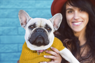 Portrait of French bulldog and smiling ownerin the background - RTBF000170
