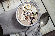 Smoothie bowl with bananas, roasted hazelnuts and other ingredients - SBDF002875