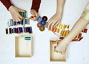 Hands sorting sewing utensils - DISF002473
