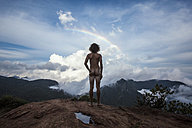 Sri Lanka, Horton Plains National Park, Rear view of nude man standing on viewing point, rainbow - WV000761