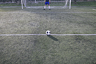 Football in front of a goal with a goalkeeper - ABZF000454