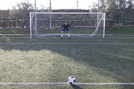 Football in front of a goal with a goalkeeper - ABZF000457