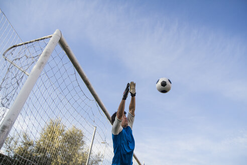 Football goalkeeper making a safe - ABZF000460