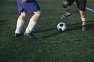 Legs of football players on football ground - ABZF000466