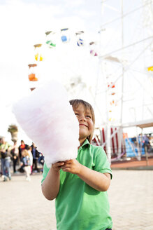 Happy little boy with cotton candy on fair - VABF000479