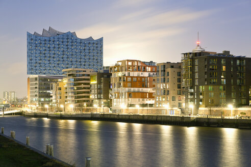 Germany, Hamburg, Hafencity, Grasbrook Harbour with Elbe Philharmonic Hall in the evening - MSF004755