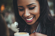 Portrait of happy young woman with cup of coffee - ZEDF000087