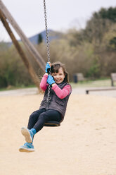 Happy girl on a swing - XCF000090