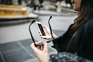 Young woman using the phone in the city - JRFF000616