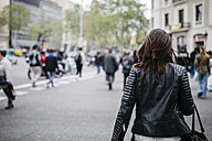 Spain, Barcelona, young woman in the city - JRFF000622