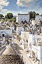 Italy, Apulia, Alberobello, Trulli, dry stone huts with conical roofs - CSTF001062
