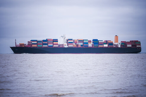 Germany, near Cuxhaven, North Sea, loaded container ship - KRPF001745