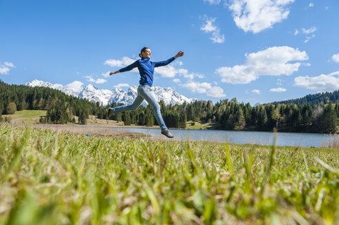 Germany, Bavaria, carefree woman at lake Barmsee - DIGF000484