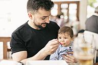 Man feeding his little son - JASF000721