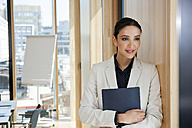 Portrait of businesswoman holding folder - CHAF001692