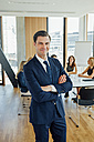 Portrait of confident businessman in a meeting - CHAF001710
