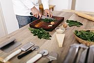 Chef preparing stuffing for ravioli, chopping spinach - JRFF000641