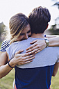 Happy woman embracing her boyfriend - GIOF000996