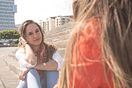 Young woman looking at friend outdoors - SIPF000444