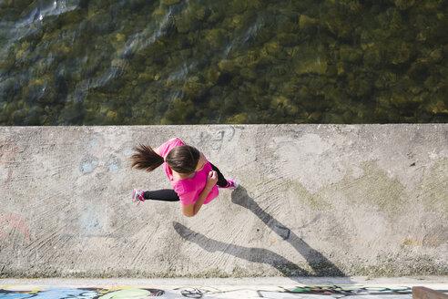 Young woman running at lakeshore - MRAF000022
