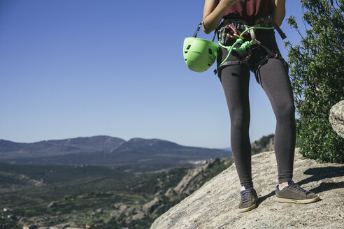 Legs of a climber woman with climbing equipment - ABZF000489