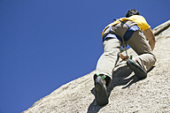 Man climbing in a granite wall - ABZF000504