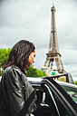 France, Paris, young woman entering a taxi - ZEDF000132
