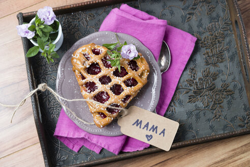 Heart-shaped cherry cake with name tag and flowers on tray - MYF001478