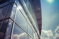 Glass facade with reflection of clouds - CMF000449