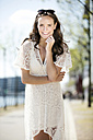 Portrait of smiling young woman wearing white summer dress - GDF000984
