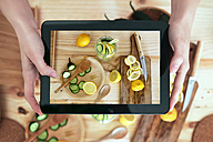 Woman photographing food with digital tablet - RTBF000208