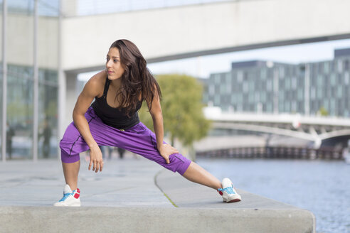 Young woman exercising at riverside - ASCF000591