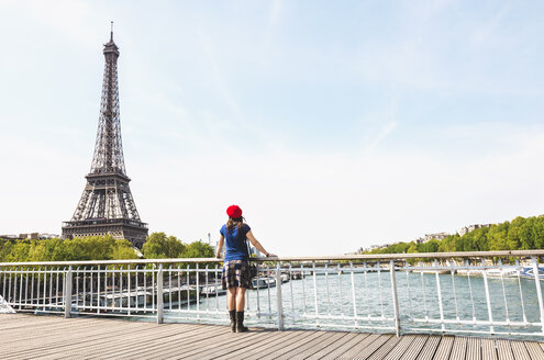 France, Paris, back view of woman wearing red beret looking at Eiffel Tower - GEMF000895