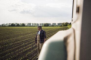 Farmer standing in a field - UUF007358