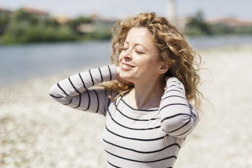 Portrait of woman enjoying sunlight - GIOF001033