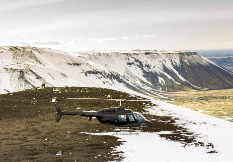 Iceland, a helicopter on a mountain - JLRF000021