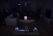 Man working at night, using computer - HAPF000432