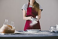 Woman preparing home made bread, sieving the flour - EBSF001390